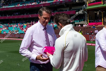 Australian player Tim Paine receives his pink cap from Glenn McGrath at the 4th Cricket Test Match between Australia and India at The Sydney Cricket Ground in Sydney