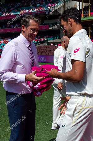 Australian player Mitchell Starc recieves his pink cap from Glenn McGrath at the 4th Cricket Test Match between Australia and India at The Sydney Cricket Ground in Sydney