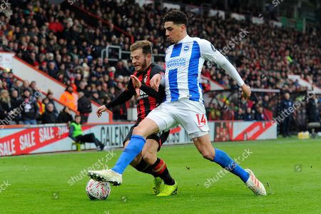 Ryan Fraser (24) of AFC Bournemouth battles for possession with Leon Balogun (14) of Brighton and Hove Albion during the The FA Cup 3rd round match between Bournemouth and Brighton and Hove Albion at the Vitality Stadium, Bournemouth
