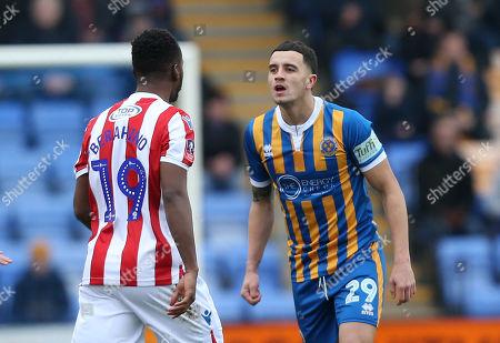 Shrewsbury Towns Oliver Norburn goes head to head with Stoke City's Saido Berahino