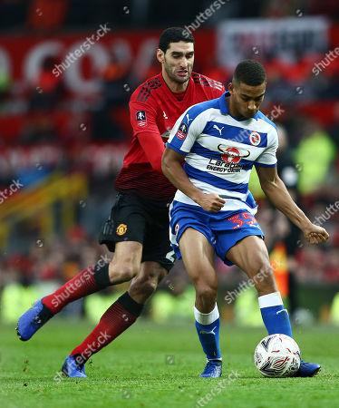 Marouane Fellaini of Manchester United and Andy Rinomhota of Reading