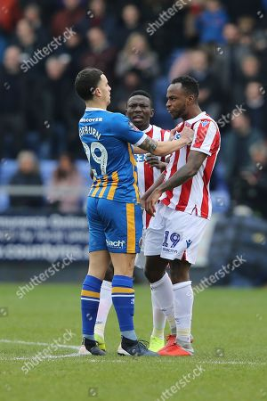 Stoke City forward Saido Berahino (19) and 29 Ollie Norburn for Shrewsbury Town clash during the The FA Cup 3rd round match between Shrewsbury Town and Stoke City at Greenhous Meadow, Shrewsbury