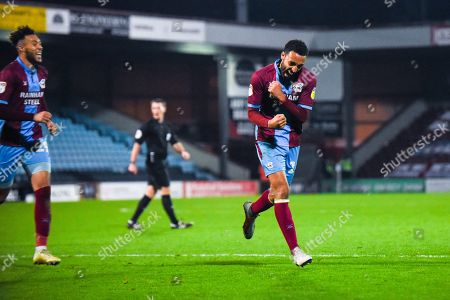 James Perch of Scunthorpe United (14) scores a goal and celebrates to make the score 1-0 during the EFL Sky Bet League 1 match between Scunthorpe United and Coventry City at Glanford Park, Scunthorpe