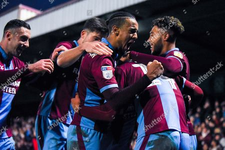 Cameron Borthwick-Jackson of Scunthorpe United (3) celebrates James Perch of Scunthorpe United (14) scoring a goal to make the score 1-0 during the EFL Sky Bet League 1 match between Scunthorpe United and Coventry City at Glanford Park, Scunthorpe