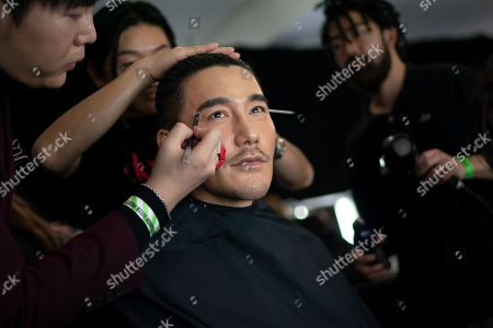 Chinese model Hu Bing is being prepared backstage to present creations by British designer Edward Crutchley during the London Fashion Week Men's, in London, Britain, 05 January 2019. The LFWM runs from 05 to 07 January.