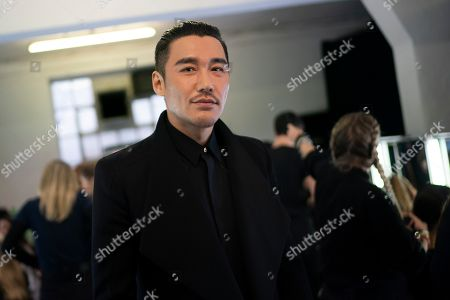 Chinese model Hu Bing waits backstage to present creations by British designer Edward Crutchley during the London Fashion Week Men's, in London, Britain, 05 January 2019. The LFWM runs from 05 to 07 January.