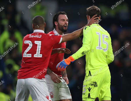 Luke Steele of Nottingham Forest is congratulated by Danny Fox and Saidy Janko after saving a penalty from Cesc Fabregas of Chelsea