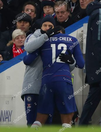 Ruben Loftus Cheek, greeted by Chelsea coach Carlo Cudicini, is substituted in the first half after  leaving the pitch with an injured back