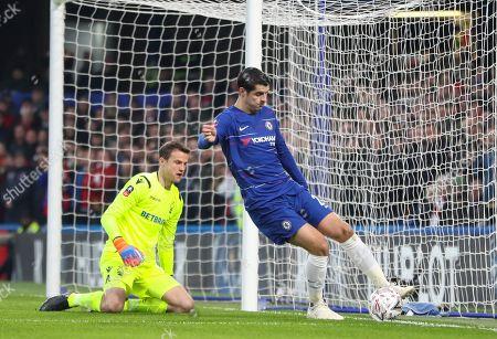 Alvaro Morata of Chelsea tries to go around Luke Steele of Nottingham Forest