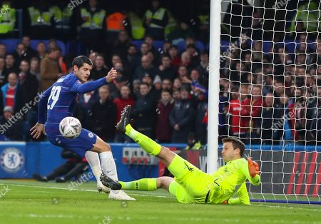 Luke Steele of Nottingham Forest makes a point blank save from a header from Alvaro Morata of Chelsea