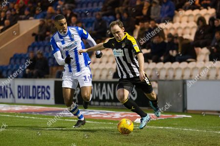 David Vaughan of Notts County clears under pressure from Mikael Mandron of Colchester United during Colchester United vs Notts County, Sky Bet EFL League 2 Football at the JobServe Community Stadium on 5th January 2019