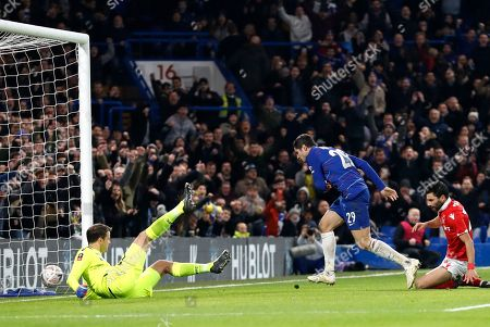 Chelsea's Alvaro Morata, center, scores the opening goal past Nottingham Forest goalkeeper Luke Steele, left, during the English FA Cup third round soccer match between Chelsea and Nottingham Forest at Stamford Bridge in London