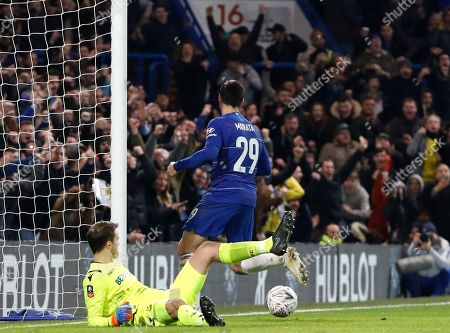 Chelsea's Alvaro Morata celebrates after scoring the opening goal past Nottingham Forest goalkeeper Luke Steele, left, during the English FA Cup third round soccer match between Chelsea and Nottingham Forest at Stamford Bridge in London