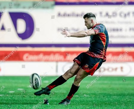 Scarlets vs Dragons. Josh Lewis of Dragons kicks a penalty