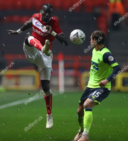 Famara Diedhiou of Bristol City and Chris Lowe of Huddersfield Town in action