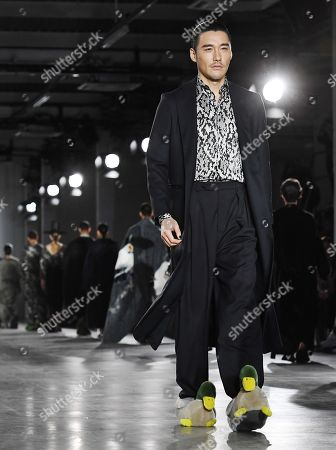 Chinese model Hu Bing presents a creation by British designer Edward Crutchley during the London Fashion Week Men's, in London, Britain, 05 January 2019. The LFWM runs from 05 to 07 January.