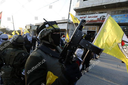 Members of Aqsa martyrs brigades attend a march to mark the 54th anniversary of Fatah movement as a political party, in the West Bank village of Bani Naem, east of Hebron, 05 January 2019. Fatah movement was founded in 1959 by late Palestinian leader Yasser Arafat before it was established as a political party on 01 January 1965.