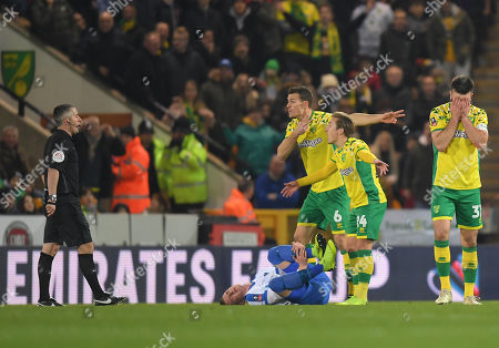 Grant Hanley of Norwich City reacts after being shown a red crad by Referee Darren Bond