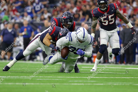 Indianapolis Colts tight end Eric Ebron (85) is tackled by Houston Texans linebacker Dylan Cole (51) during the second quarter during the AFC Wildcard game at NRG Stadium in Houston, TX