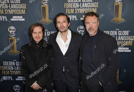 Tom Schilling (L) and Sebastian Koch (R) and producer Quirin Berg (C) as he arrives for the 2019 Golden Globe Foreign-Language Film Symposium at the Liaison Restaurant and Lounge, in Hollywood, California, USA, 05 January 2019. Henckel von Donnersmarck is nominated for his film Never Look Away.