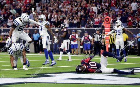 Stock Image of Mike Mitchell, Anthony Walker, Darius Leonard DeAndre Hopkins. Indianapolis Colts defenders Mike Mitchell (34), Anthony Walker (50) and Darius Leonard (53) celebrate after breaking up a pass intended for Houston Texans wide receiver DeAndre Hopkins (10) on a fourth down during the first half of an NFL wild card playoff football game, in Houston