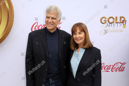 Stock Photo of Mark Spitz, Suzy Spitz. Mark Spitz, left, and Suzy Spitz arrive at the '6th Annual Gold Meets Golden', in West Hollywood, Calif