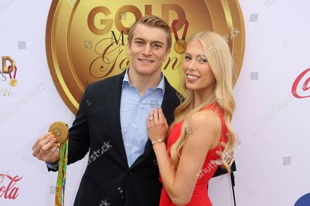 Connor Fields, Laura Gruninger. Connor Fields, left, and girlfriend Laura Gruninger arrive at the '6th Annual Gold Meets Golden', in West Hollywood, Calif