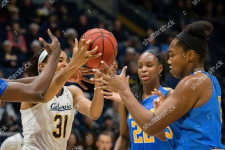 Cal's Kristine Anigwe fights for a loose ball against UCLA's Lauren Miller, rt, during an NCAA college basketball game at Haas Pavilion, in Berkeley, Calif. UCLA won 84-79