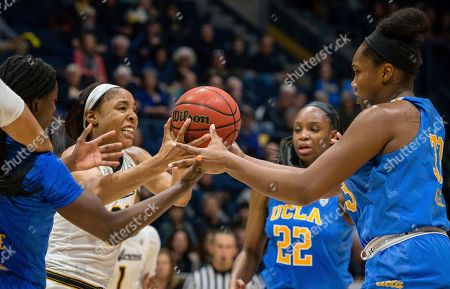 Cal's Kristine Anigwe fights for a loose ball with UCLA's Lauren Miller during an NCAA college basketball game at Haas Pavilion, in Berkeley, Calif. UCLA won 84-79