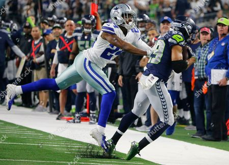 Dallas Cowboys cornerback Chidobe Awuzie (24) defends as Seattle Seahawks wide receiver Doug Baldwin (89) catches a pass during the second half of the NFC wild-card NFL football game in Arlington, Texas