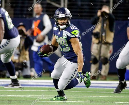 Seattle Seahawks wide receiver Doug Baldwin (89) runs after a reception against the Dallas Cowboys during the second half of the NFC wild-card NFL football game in Arlington, Texas