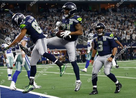 (L-R) Seattle Seahawks wide receiver Doug Baldwin, running back JD McKissic and quarterback Russell Wilson celebrate McKissic's touchdown against the Dallas Cowboys in the second half of their NFC Wild Card playoff game against the Seattle Seahawks at AT&T Stadium in Arlington, Texas, USA, 05 January 2019.