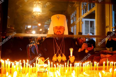 Patriarch Bartholomew I, Petro Poroshenko, Metropolitan Epiphanius. Metropolitan Epiphanius, the head of the independent Ukrainian Orthodox Church lights candles prior to a religion service at the Patriarchal Church of St. George in Istanbul, . The Ecumenical Patriarch of Constantinople has signed a decree of independence for the Orthodox Church of Ukraine