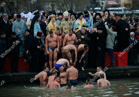 Ecumenical Patriarch Bartholomew I, center left, and Metropolitan Epiphanius, the head of the independent Ukrainian Orthodox Church bless men during the Epiphany ceremony in Istanbul, . The Ecumenical Patriarch of Constantinople on Sunday presented a decree of independence to the head of the nascent Orthodox Church of Ukraine, formally severing it from the Russian Orthodox Church