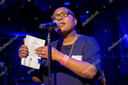 Meshell Ndegeocello holds a copy of James Baldwin's 'A Fire Next Time,' inspiration for her performance piece/ritual 'No More Water, The Fire Next Time'