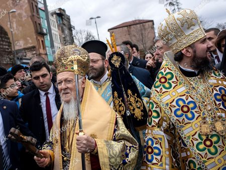 Greek Orthodox Ecumenical Patriarch Bartholomew I of Constantinople (L) and Metropolitan Epifaniy (R), the head of the united local Ukrainian Orthodox Church walk on street after the Epiphany Day ceremony in Istanbul, Turkey, 06 January 2019. Greek Orthodox swimmers take part in an annual race to retrieve a wooden crucifix thrown into the Bosphorus waters at the Golden Horn.