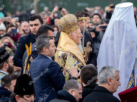 Greek Orthodox Ecumenical Patriarch Bartholomew I of Constantinople (C) attends the Epiphany Day ceremony in Istanbul, Turkey, 06 January 2019. Greek Orthodox swimmers take part in an annual race to retrieve a wooden crucifix thrown into the Bosphorus waters at the Golden Horn.