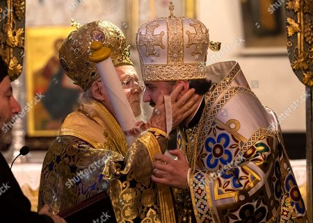 Ecumenical Patriarch Bartholomew I of Constantinople (L) kisses the Metropolitan Epifaniy (R), the head of the united local Ukrainian Orthodox Church, as they attend the handing ceremony of the Tomos decree of autocephaly for Ukrainian church at the Patriarchal Church of St. George in Istanbul, Turkey, 06 January 2019. The Metropolitan Epifaniy and top Ukrainian officials arrived in Turkey for the ceremony of the Tomos of autocephaly for newly elected the head of Ukraine Orthodox Church in Istanbul.