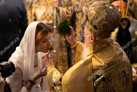 Maryna Poroshenko (L), the wife of Ukrainian President Petro Poroshenko kisses the hand of Ecumenical Patriarch Bartholomew I of Constantinople (R) as they attend the handing ceremony of the Tomos decree of autocephaly for Ukrainian church at the Patriarchal Church of St. George in Istanbul, Turkey, 06 January 2019. The Metropolitan Epifaniy and top Ukrainian officials arrived in Turkey for the ceremony of the Tomos of autocephaly for newly elected the head of Ukraine Orthodox Church in Istanbul.
