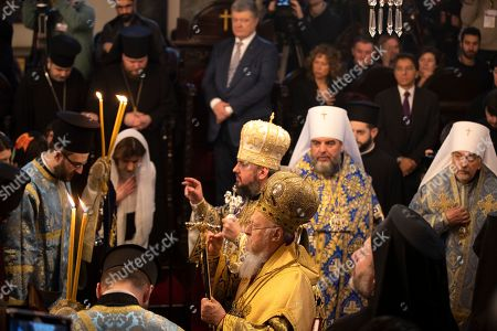 Ukrainian President Petro Poroshenko (back-up) watches as Ecumenical Patriarch Bartholomew I of Constantinople (front) and the Metropolitan Epifaniy (back-C), the head of the united local Ukrainian Orthodox Church, attend the handing ceremony of the Tomos decree of autocephaly for Ukrainian church at the Patriarchal Church of St. George in Istanbul, Turkey, 06 January 2019. The Metropolitan Epifaniy and top Ukrainian officials arrived in Turkey for the ceremony of the Tomos of autocephaly for newly elected the head of Ukraine Orthodox Church in Istanbul.