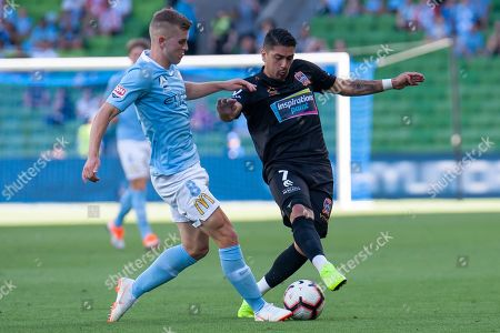 Melbourne City midfielder Riley McGree (8) competes with Newcastle Jets forward Dimitri Petratos (7) for the ball