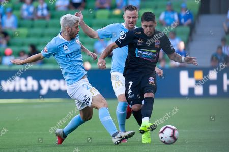 Newcastle Jets forward Dimitri Petratos (7) competes for the ball