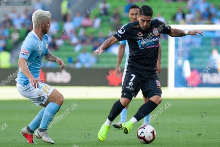 Newcastle Jets forward Dimitri Petratos (7) controls the ball