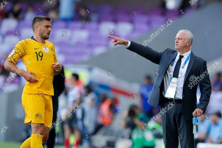 Australia's head coach Graham Arnold, right, gives instructions from the side line next to Australia's defender Josh Risdon during the AFC Asian Cup group B soccer match between Australia and Jordan at Hazza bin Zayed stadium in Al Ain, United Arab Emirates