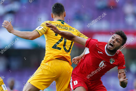 Jordan's midfielder Said Murjan, right, and Australia's defender Trent Sainsbury fight for a high ball during the AFC Asian Cup group B soccer match between Australia and Jordan at Hazza bin Zayed stadium in Al Ain, United Arab Emirates
