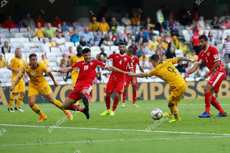 Australia's forward Jamie Maclaren, second right, attempts a shoot past Jordan's defender Anas Bani Yaseen, second left, during the AFC Asian Cup group B soccer match between Australia and Jordan at Hazza bin Zayed stadium in Al Ain, United Arab Emirates