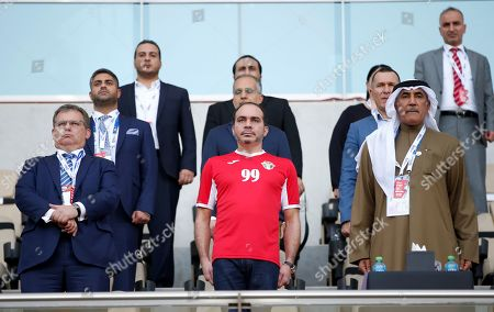 Major General Mohammed Khalfan Al Romaithi  (R) Commander-in-Chief of Abu Dhabi Police and Chairman of the Board of Directors of the General Authority for Sports and His Royal Highness Prince Ali Bin Al Hussein (C) the President of the Jordan Football Association listen to the National anthem before the 2019 AFC Asian Cup group B preliminary round match between Australia and Jordan in Al Ain, United Arab Emirates, 06 January 2019.