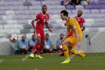 Australia's midfielder Robbie Kruse missed the ball during the AFC Asian Cup group B soccer match between Australia and Jordan at the Hazza Bin Zayed stadium in Al Ain, United Arab Emirates
