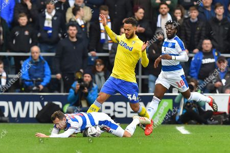 Lewis Baker (34) of Leeds United fouls Josh Scowen (11) of Queens Park Rangers during the The FA Cup 3rd round match between Queens Park Rangers and Leeds United at the Loftus Road Stadium, London