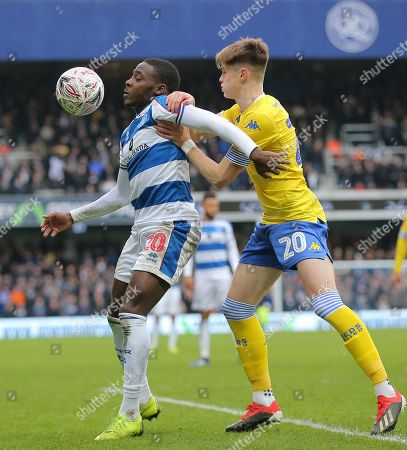 Bright Osavi-Samuel of Queens Park Rangers battles with  Tom Pearce of Leeds United